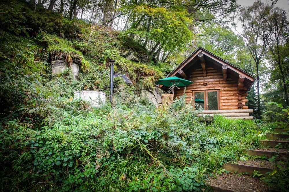 A tiny shack has a charming rustic exterior