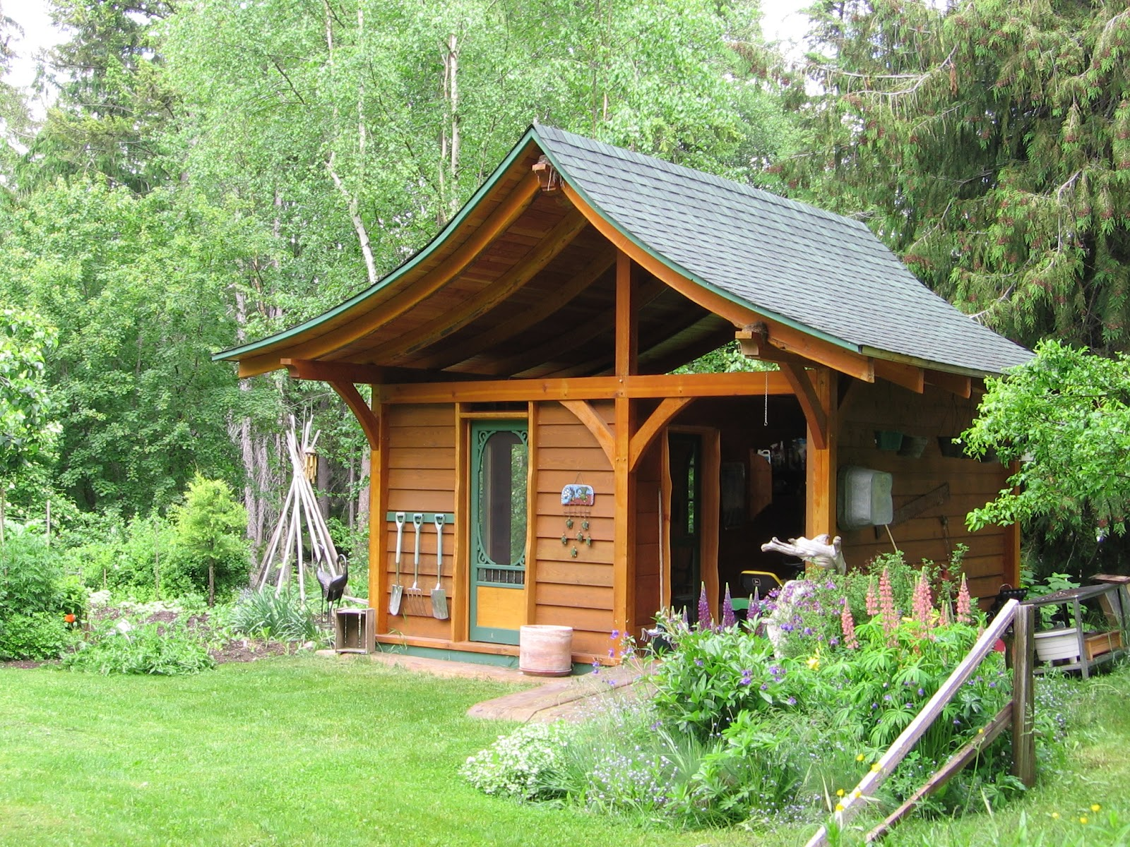 Fairytale backyards 30 magical garden sheds for Outdoor wood shed