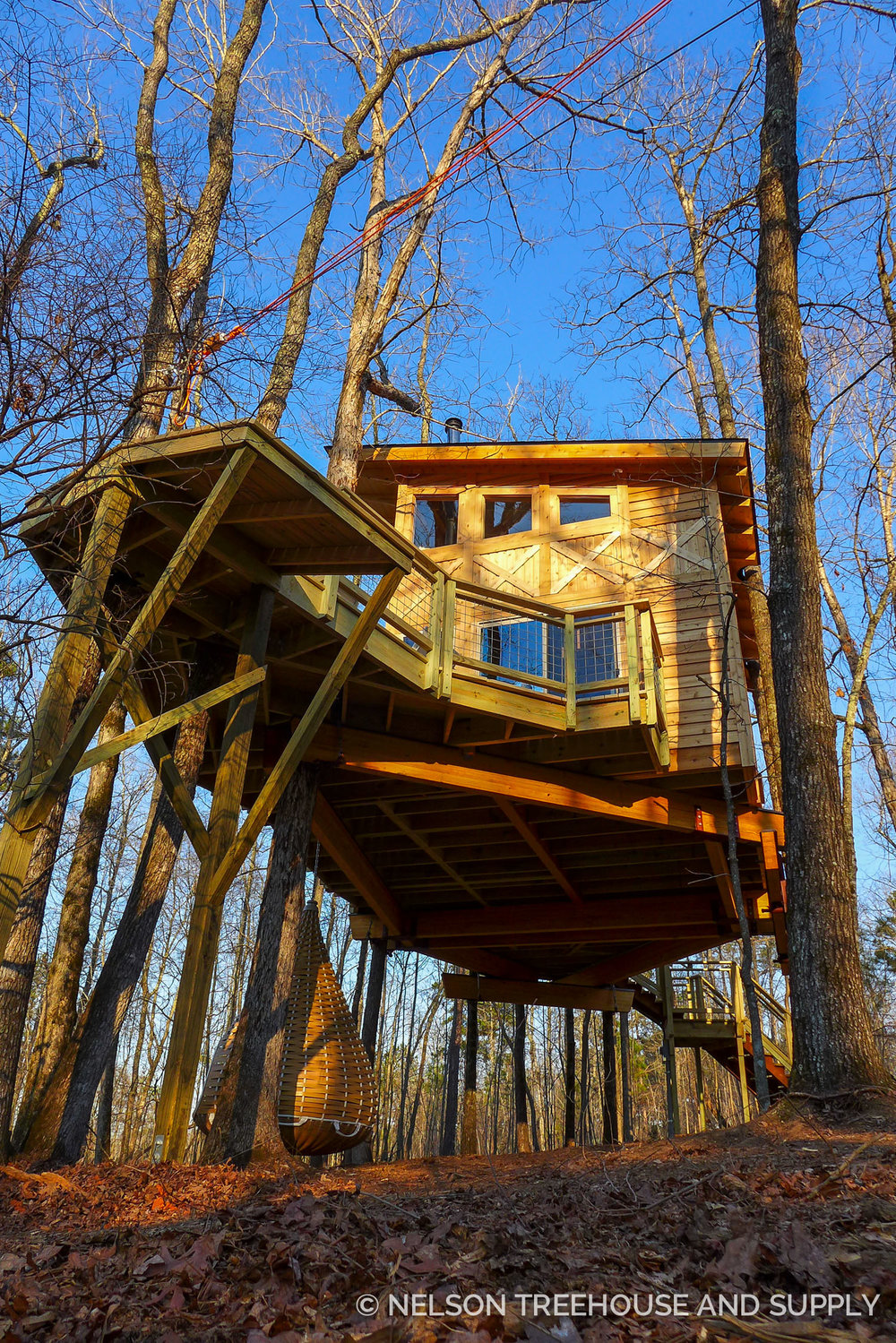 A wooden treehouse that blends in with the trees