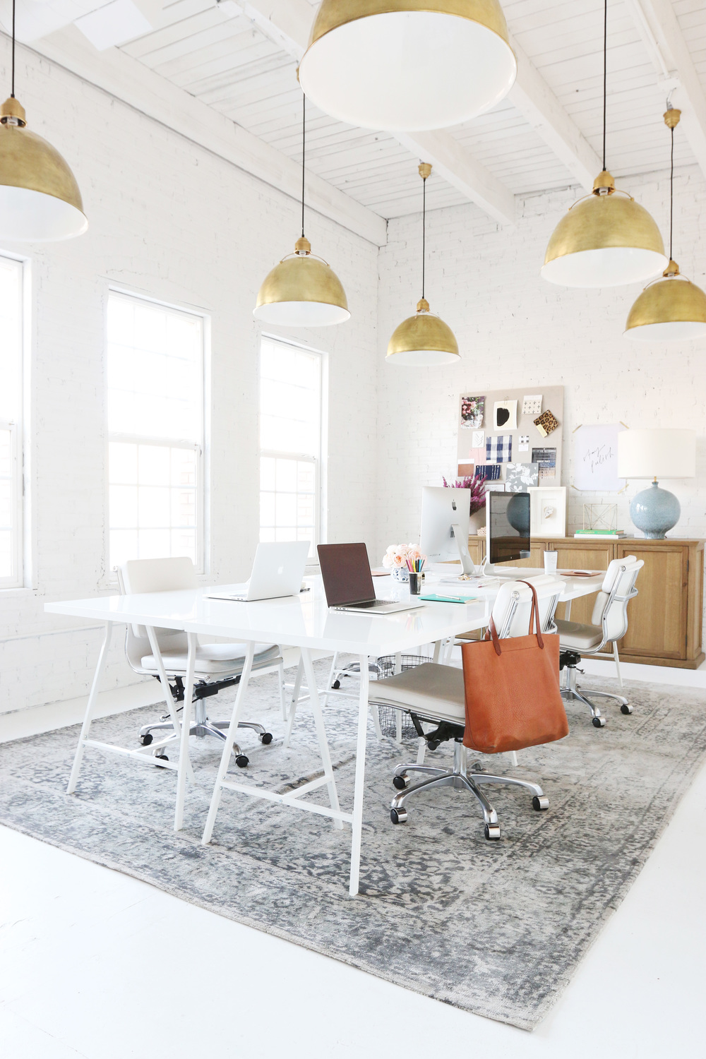All-white office with golden lamps
