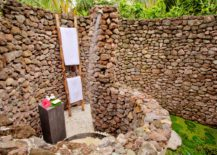 An-outdoor-shower-made-of-countless-little-stones--217x155