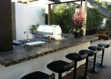 Bar-inspired-outdoor-kitchen-with-cute-bar-stools--217x155