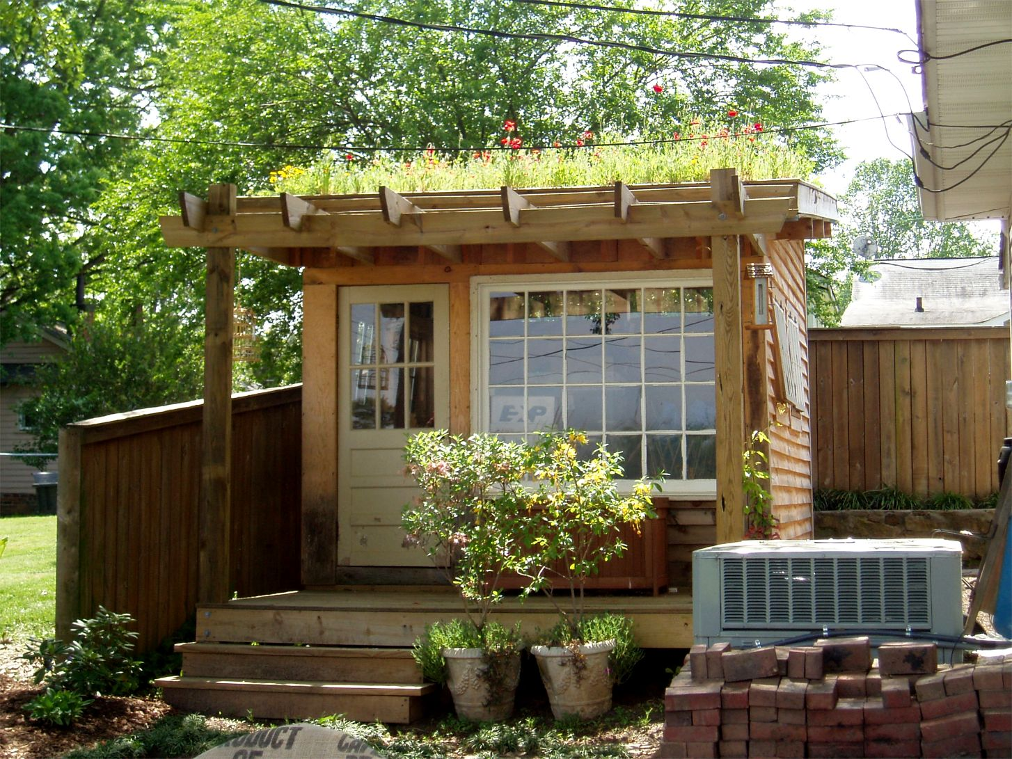Beautiful backyard shed with a wooden exterior