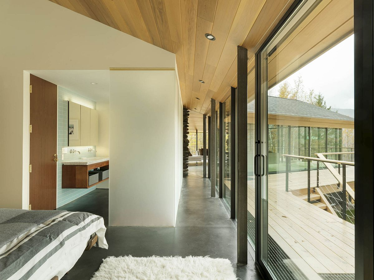 Bedroom-connected-with-the-balcony-through-large-glass-doors