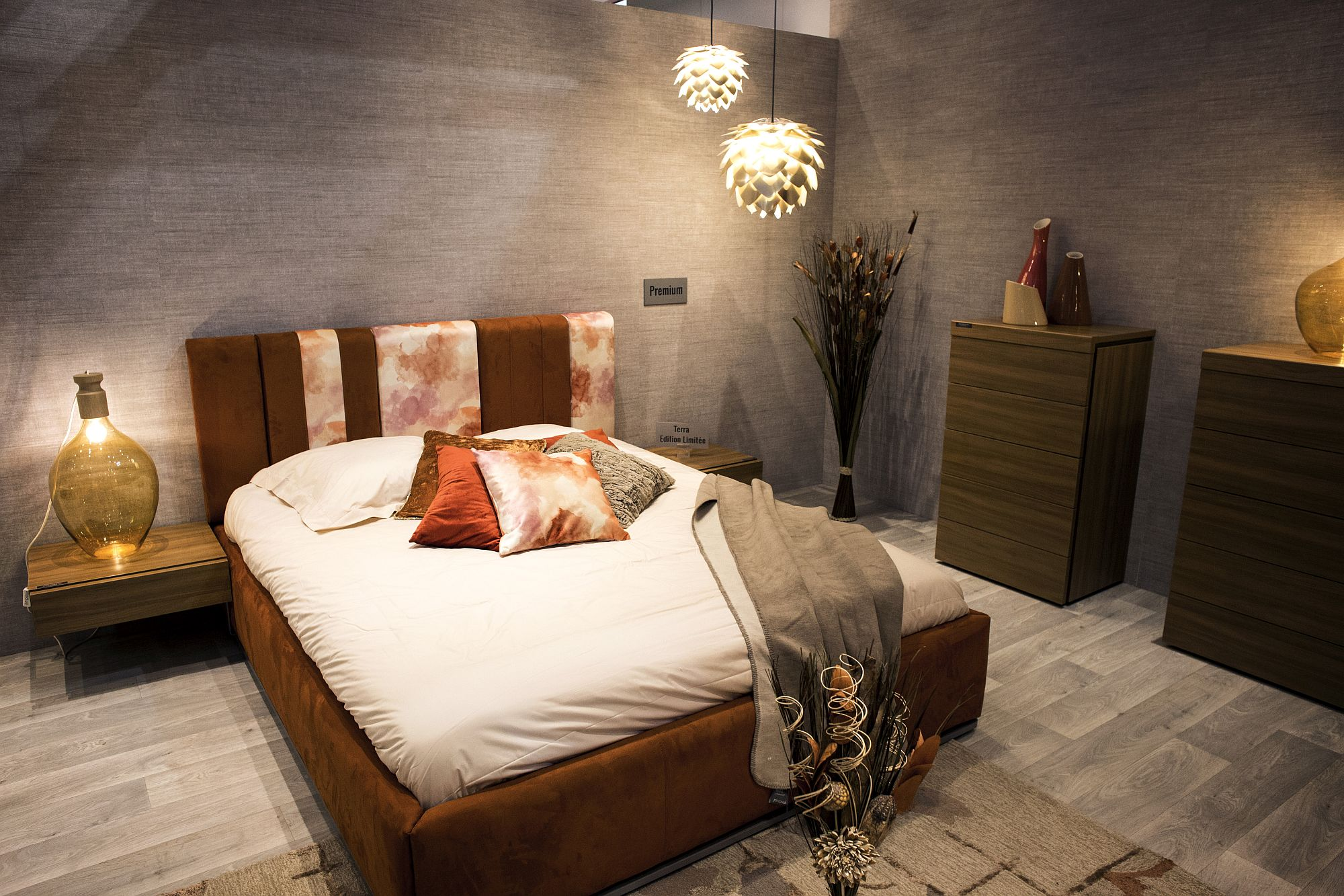 Burnt orange brings color and glamor to the modern bedroom with innovative lighting