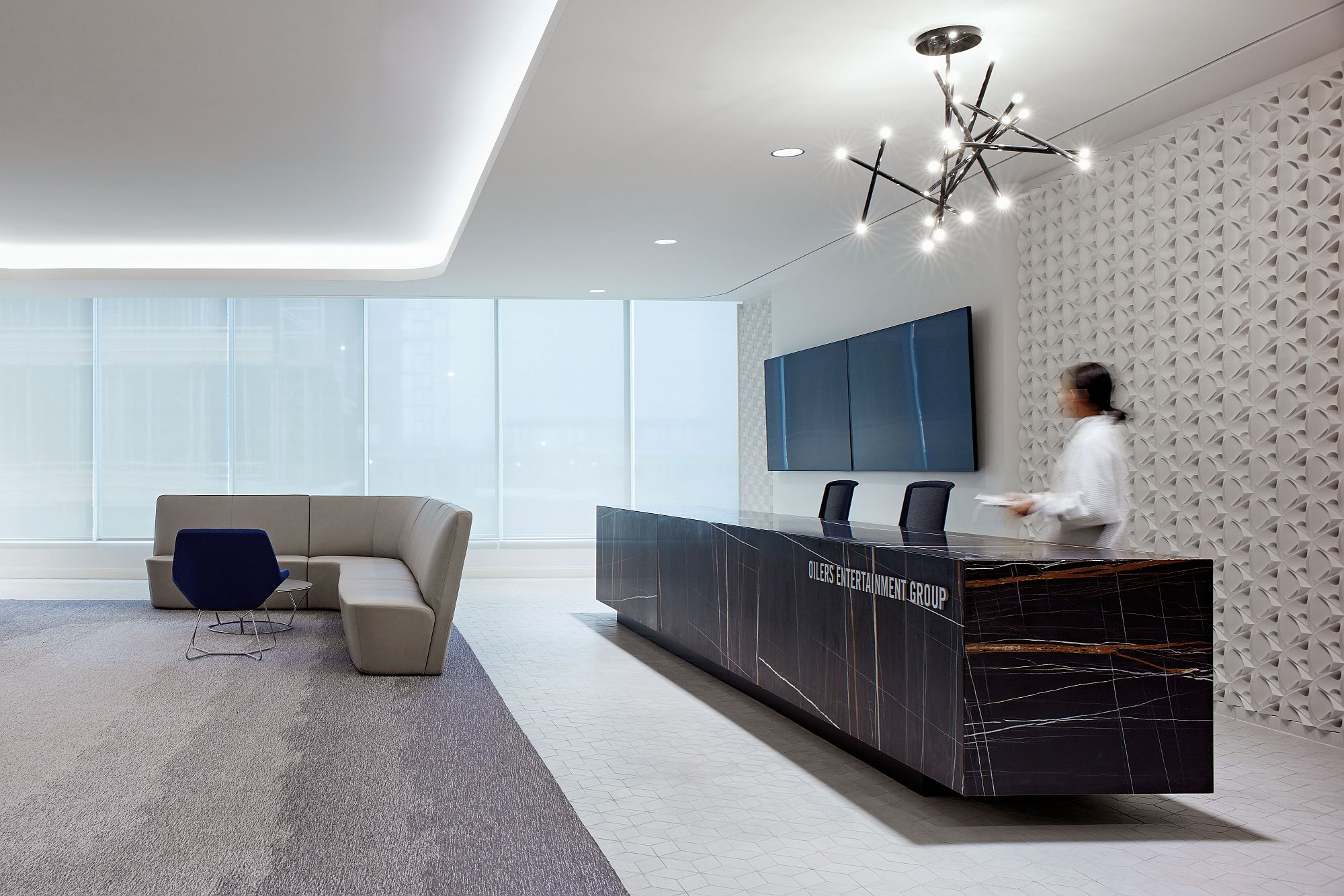 Captivating and sophisticated reception of the OEG office Inventive Oilers Entertainment Group Office Inspired by Ice Hockey Motifs