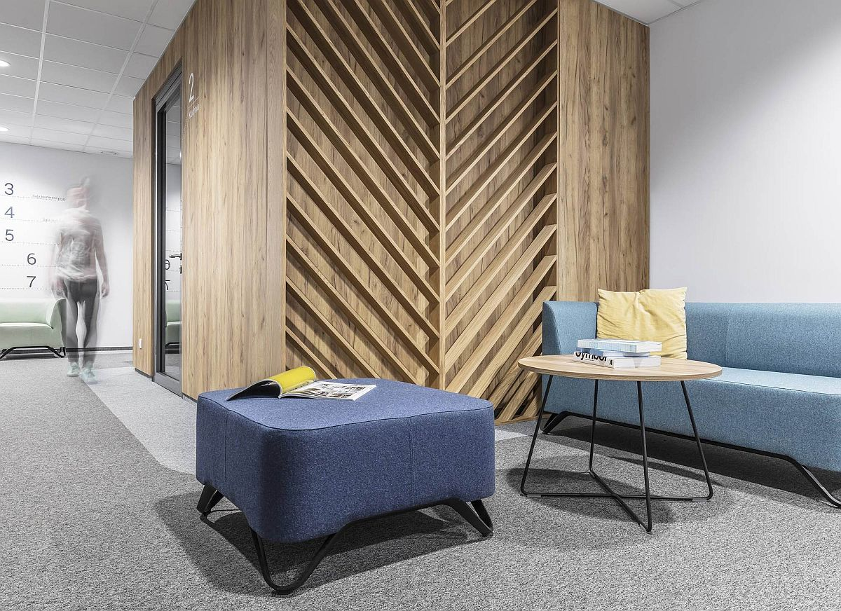 Chevron and herringbone patterns in wood add individuality to the office space