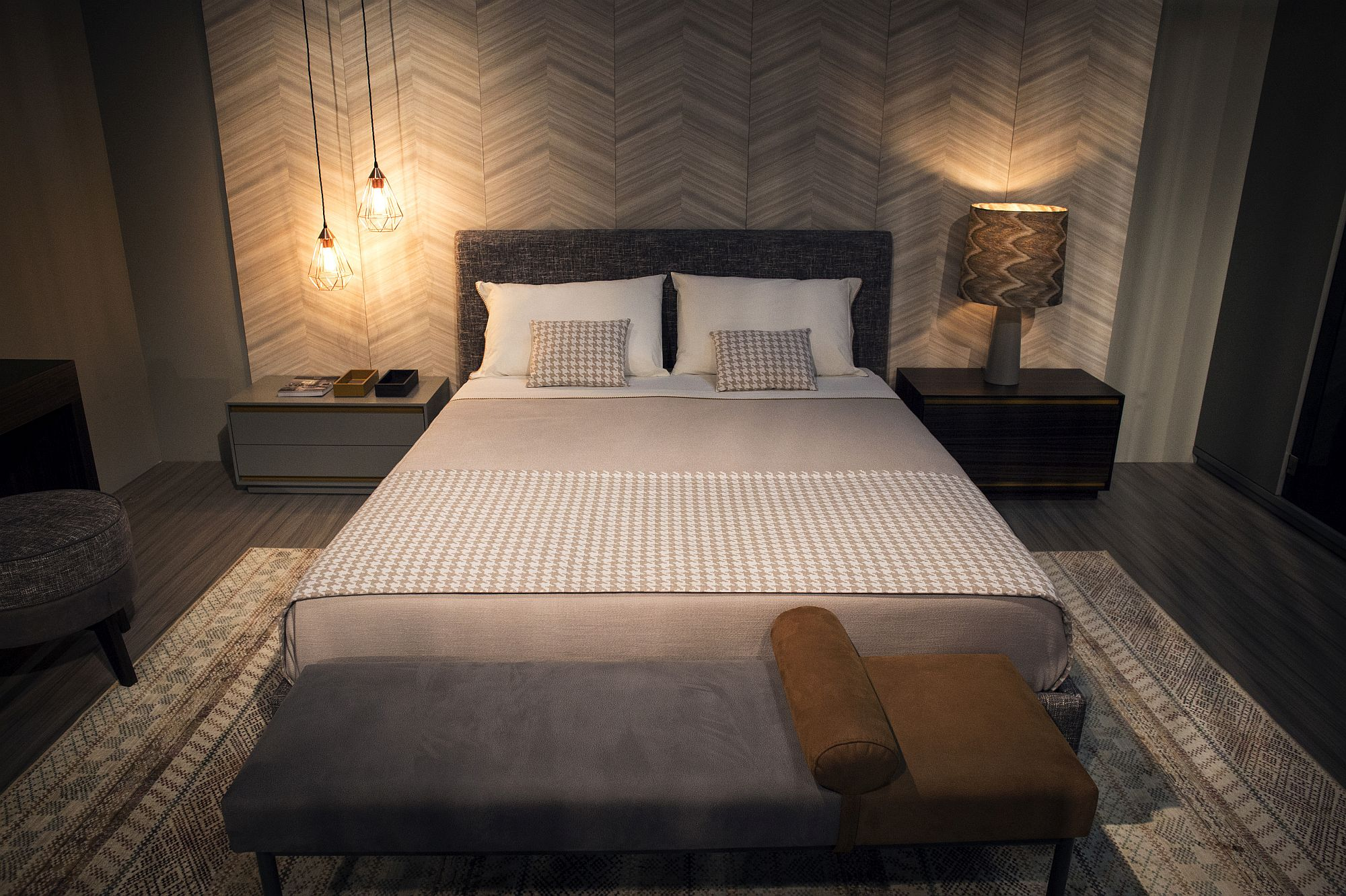 Chevron pattern in the backdrop adds to the geo style of the bedroom
