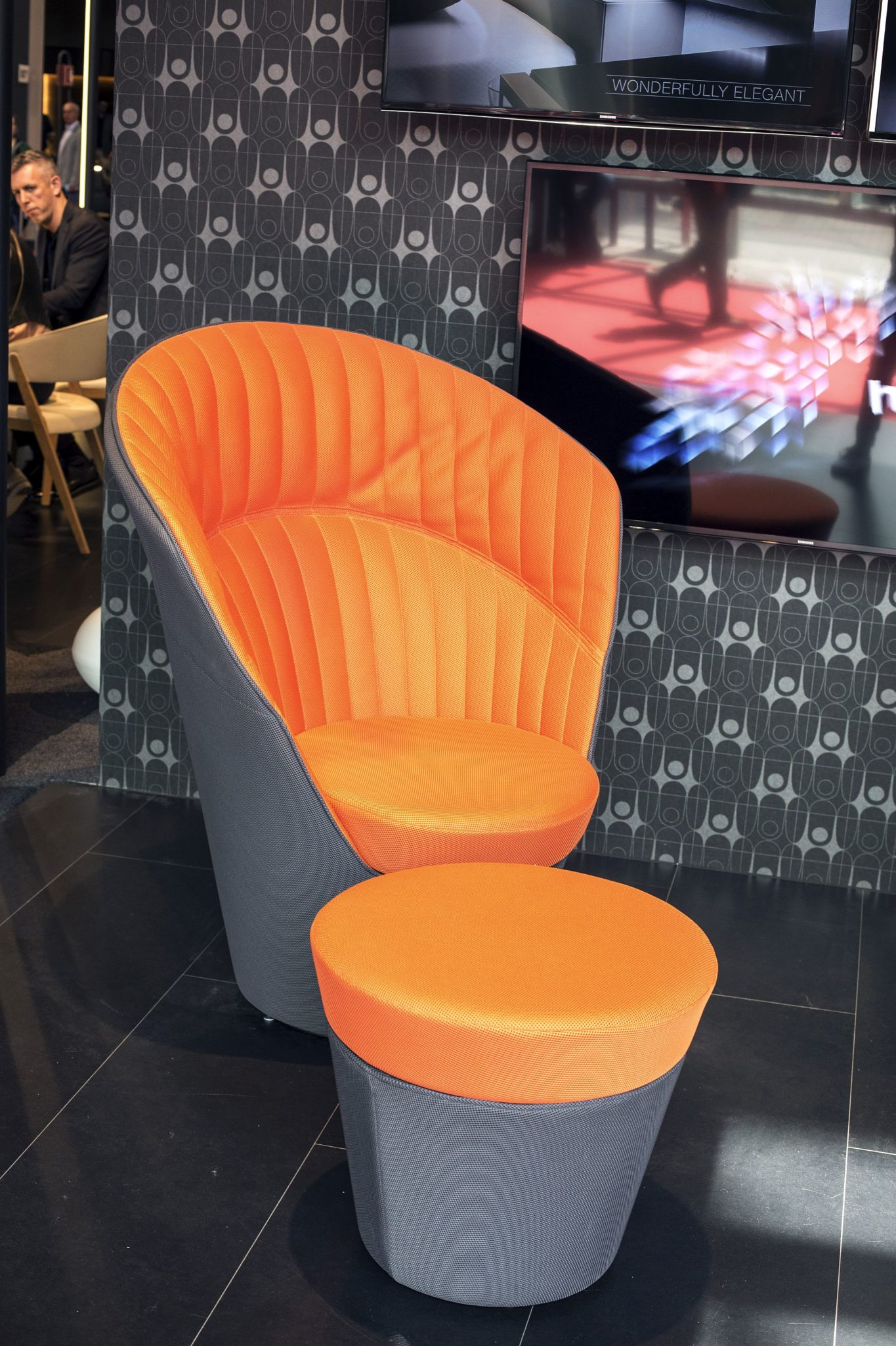 Comfortable high back chair from Huelsta in gray and orange