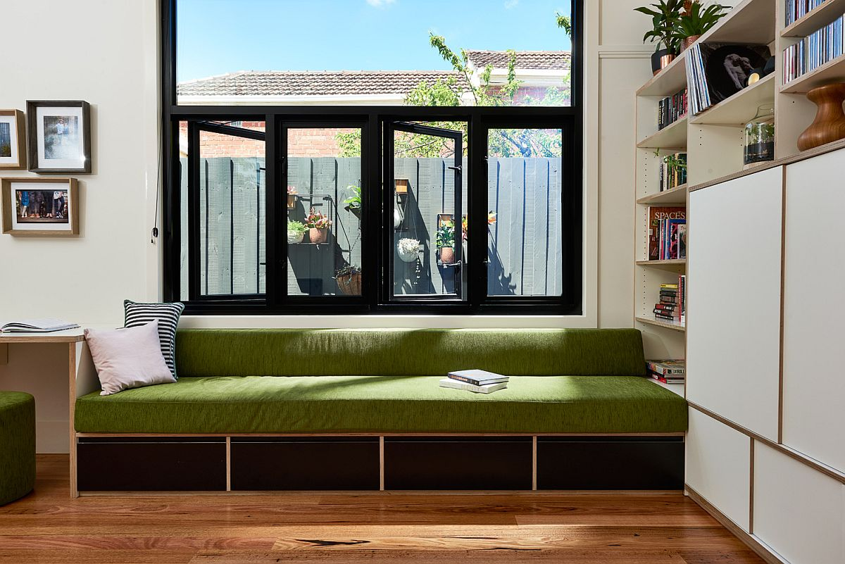 Comfy daybed in green for study room with storage space underneath