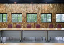 Conference-room-with-wooden-walls-and-track-lighting-217x155