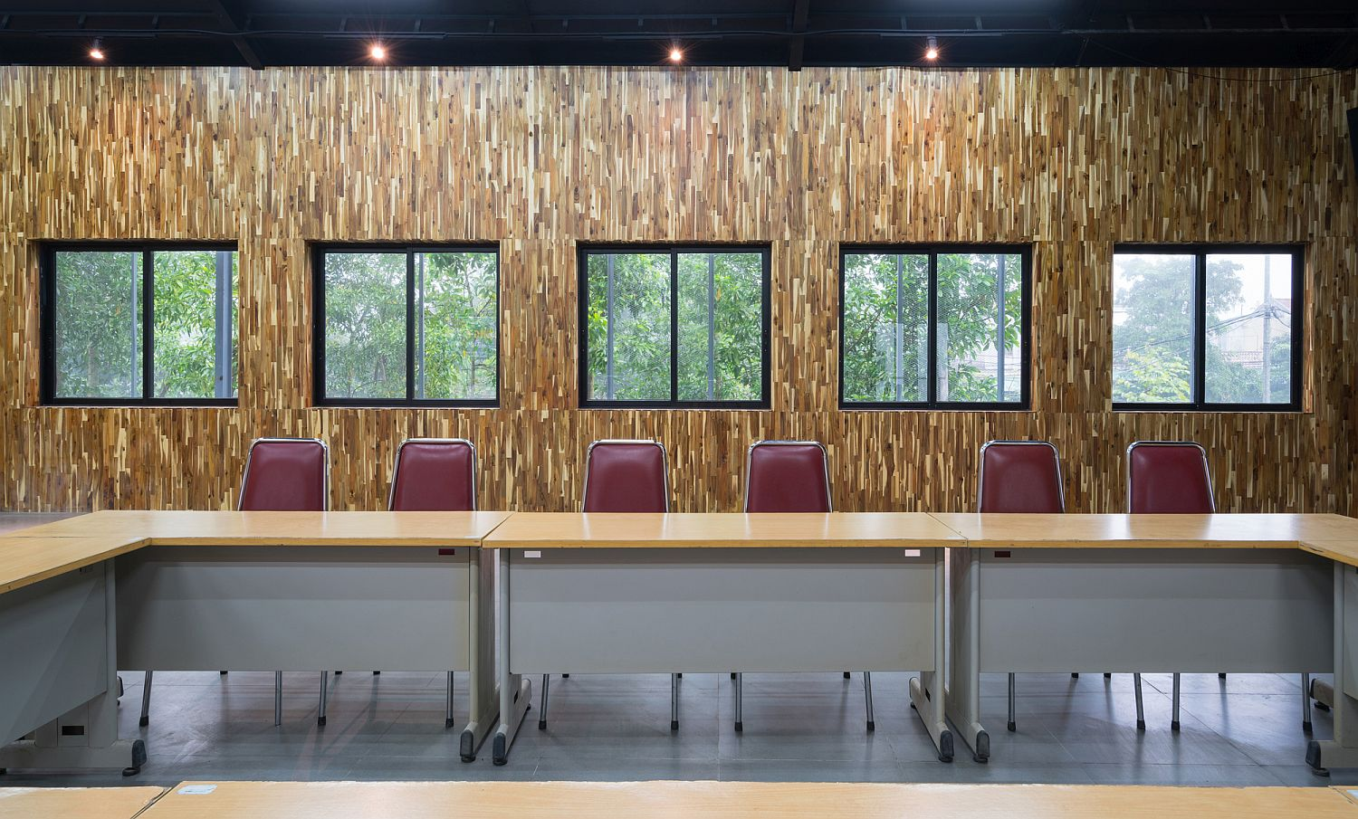 Conference room with wooden walls and track lighting