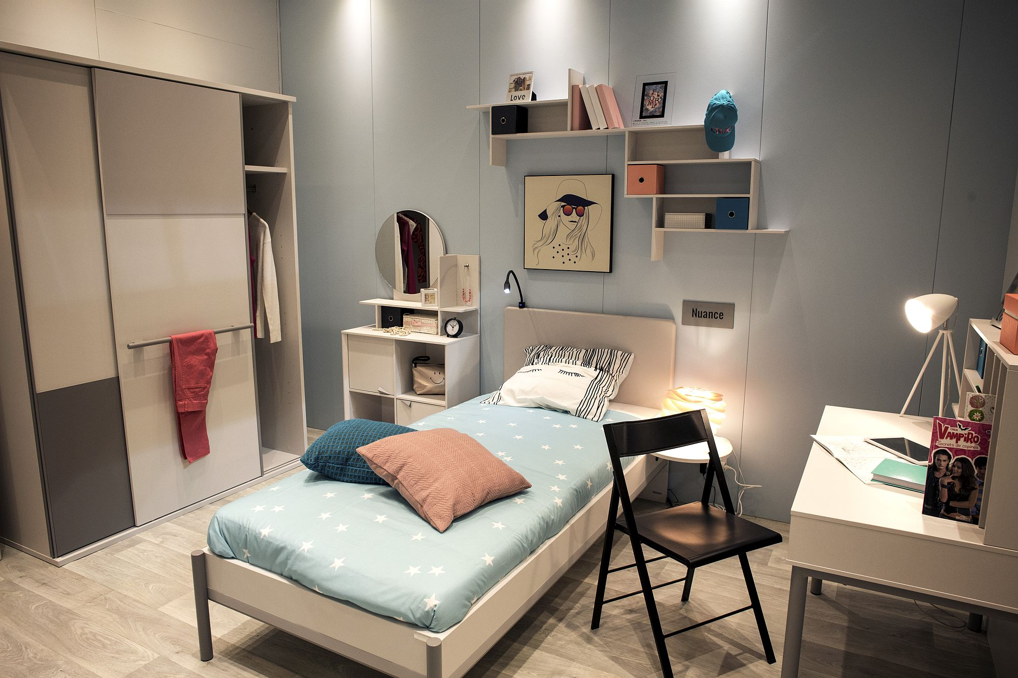 Contemporary kids room in light blue and white