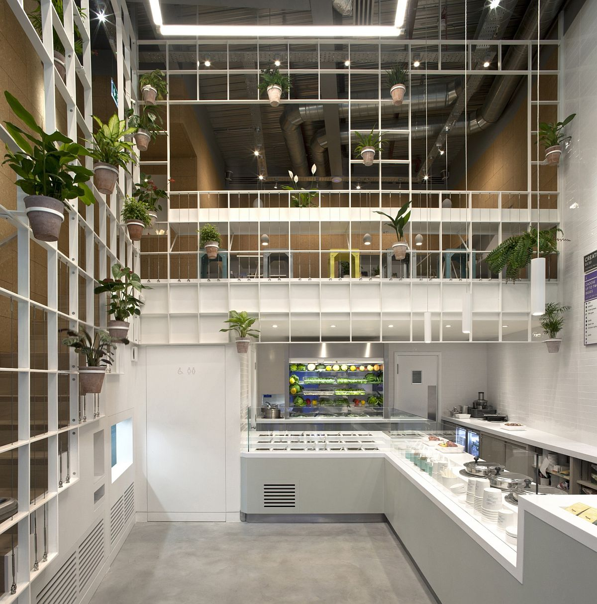 Creative salad and slow food café in London Custom Metallic Grid Brings a Vibrant Green Display to This London Café