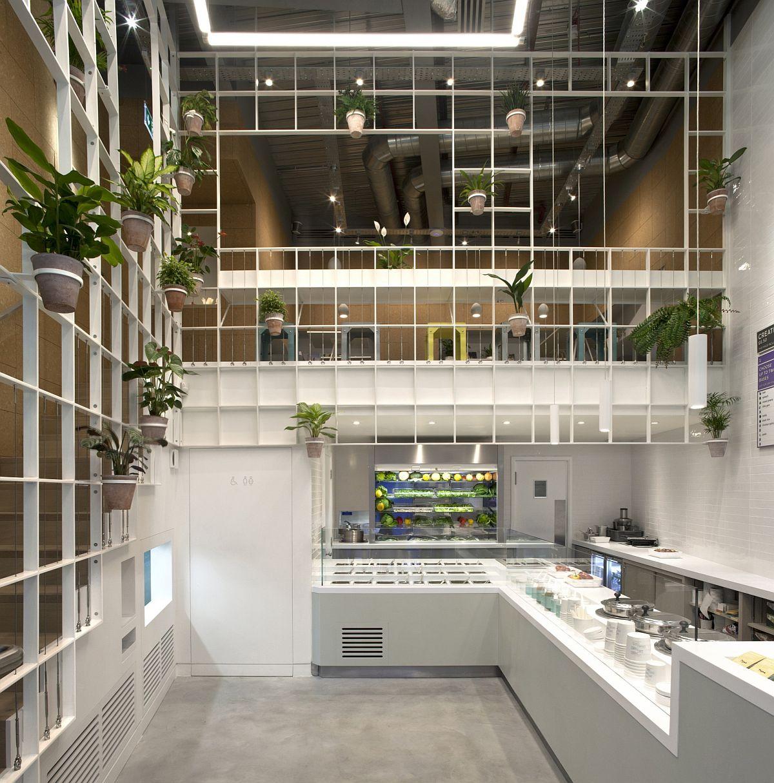 Custom metallic grid brings a vibrant green display to this london café