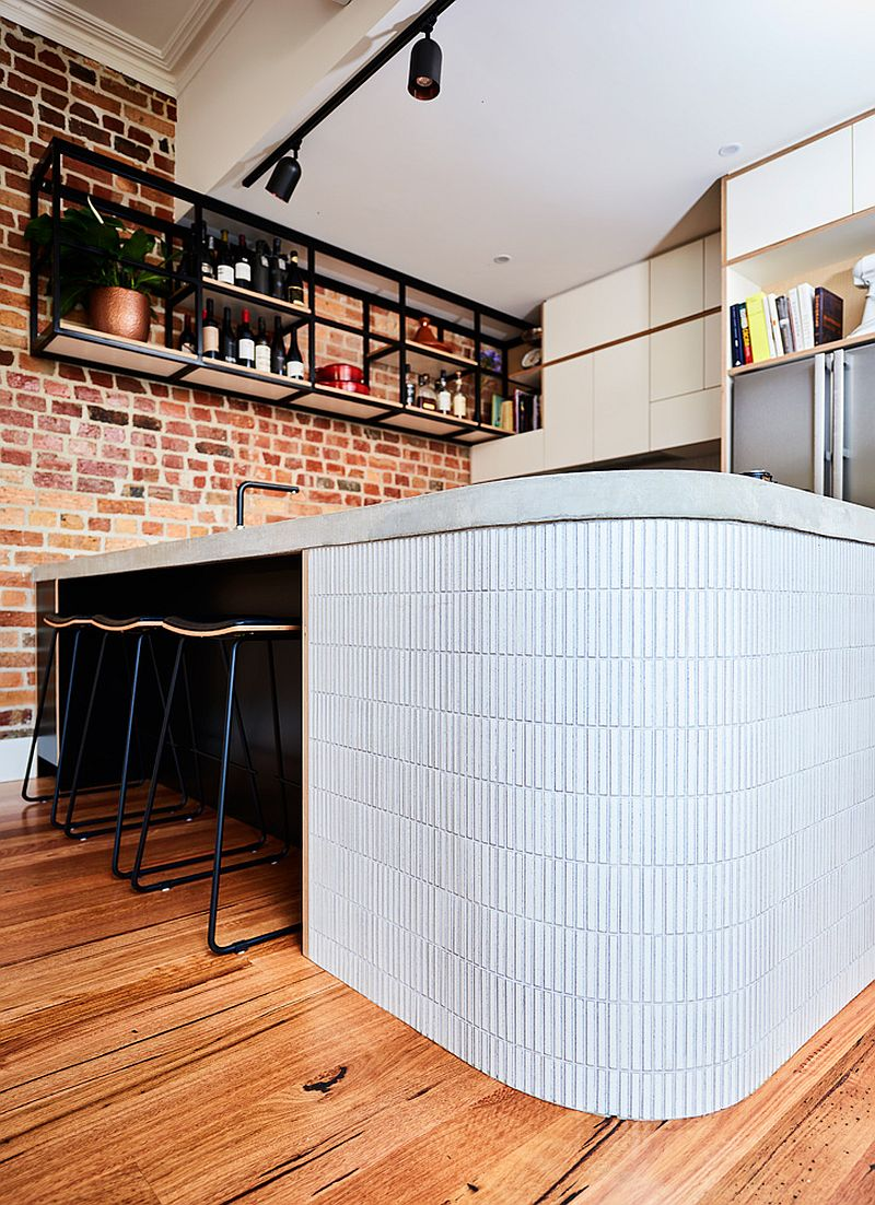 Curvy end to the kitchen island makes it a safer, kid-friendly option