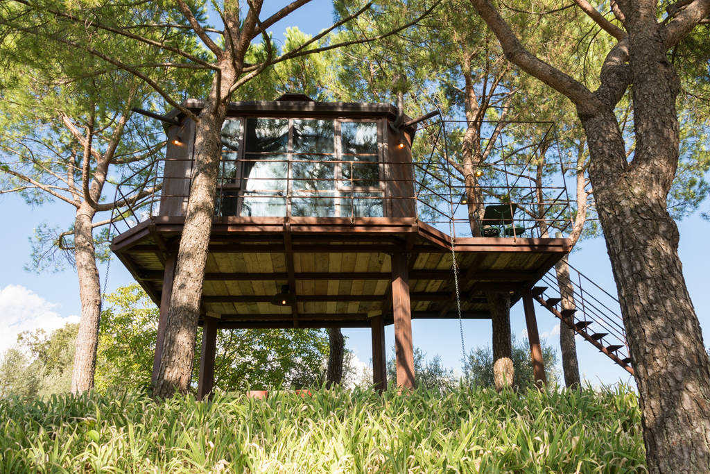 Dark brown modern treehouse that matches the trees