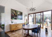 Dining-area-with-wooden-flooring-to-demarcate-it-from-the-living-space-and-kitchen-217x155