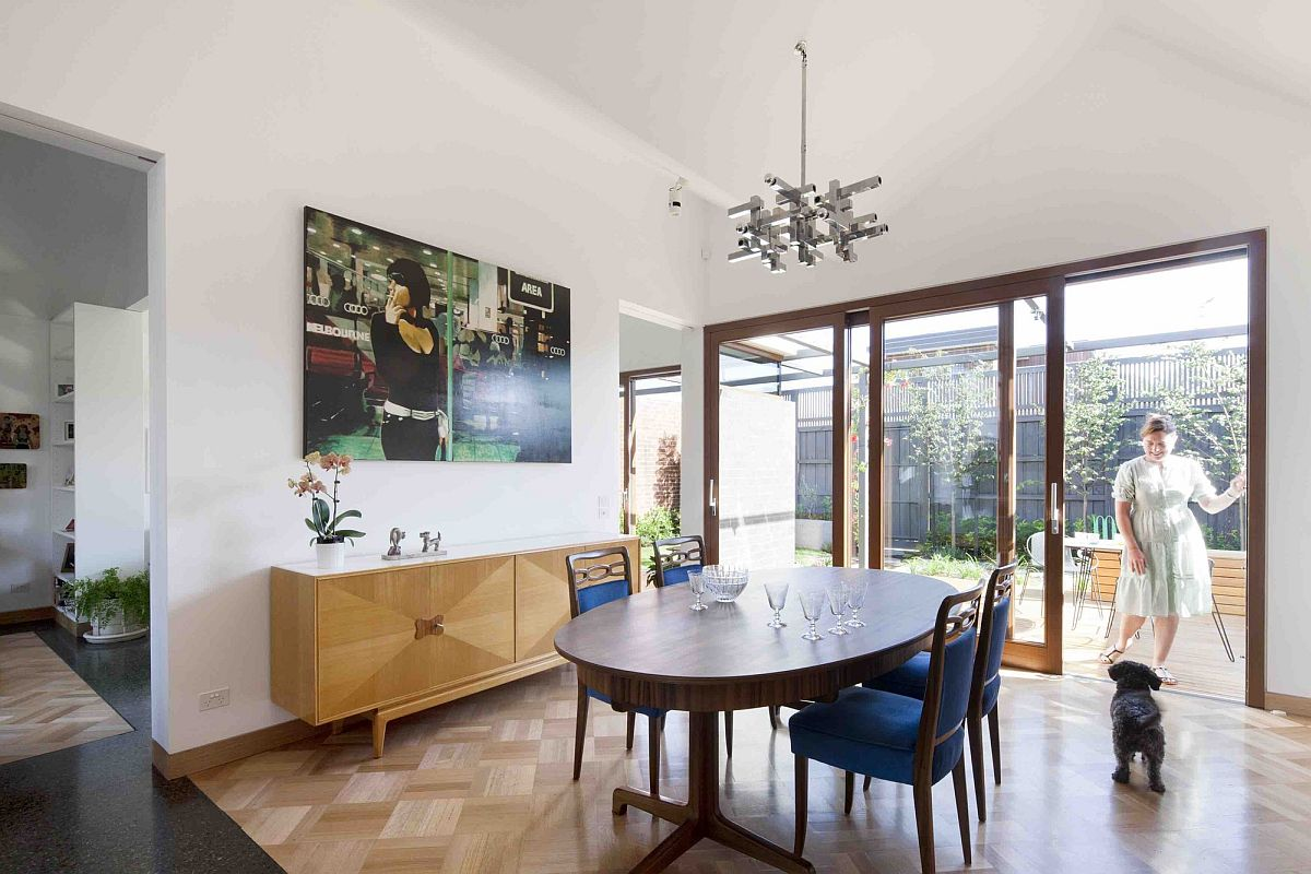 Dining-area-with-wooden-flooring-to-demarcate-it-from-the-living-space-and-kitchen