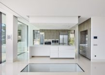 Earthy-flavor-combined-with-white-minimalism-in-the-contemporary-kitchen-217x155
