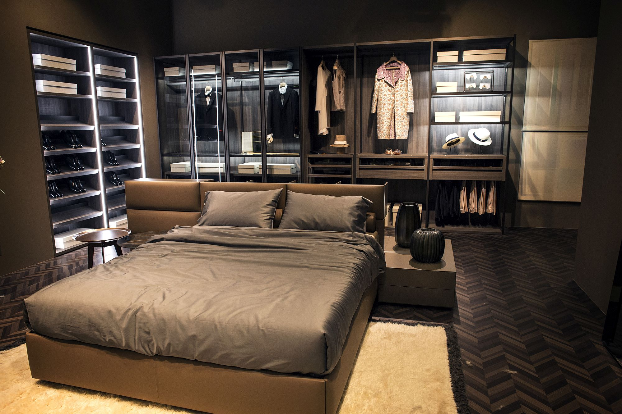 Elegant bedroom closet around the bed utilizes vertical space to the hilt