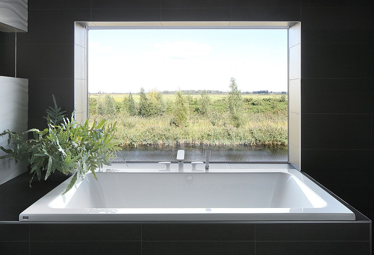 Elegantly framed view of the landscape from the bathtub