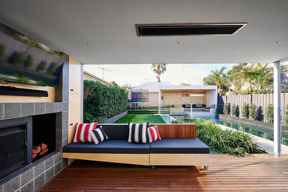 Fireplace, TV and movable seating of the outdoor hangout