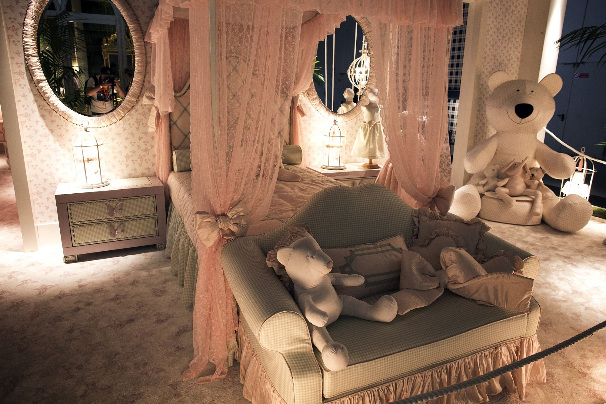 Four poster bed with canopy becomes the focal point of the lavish princess themed kids room