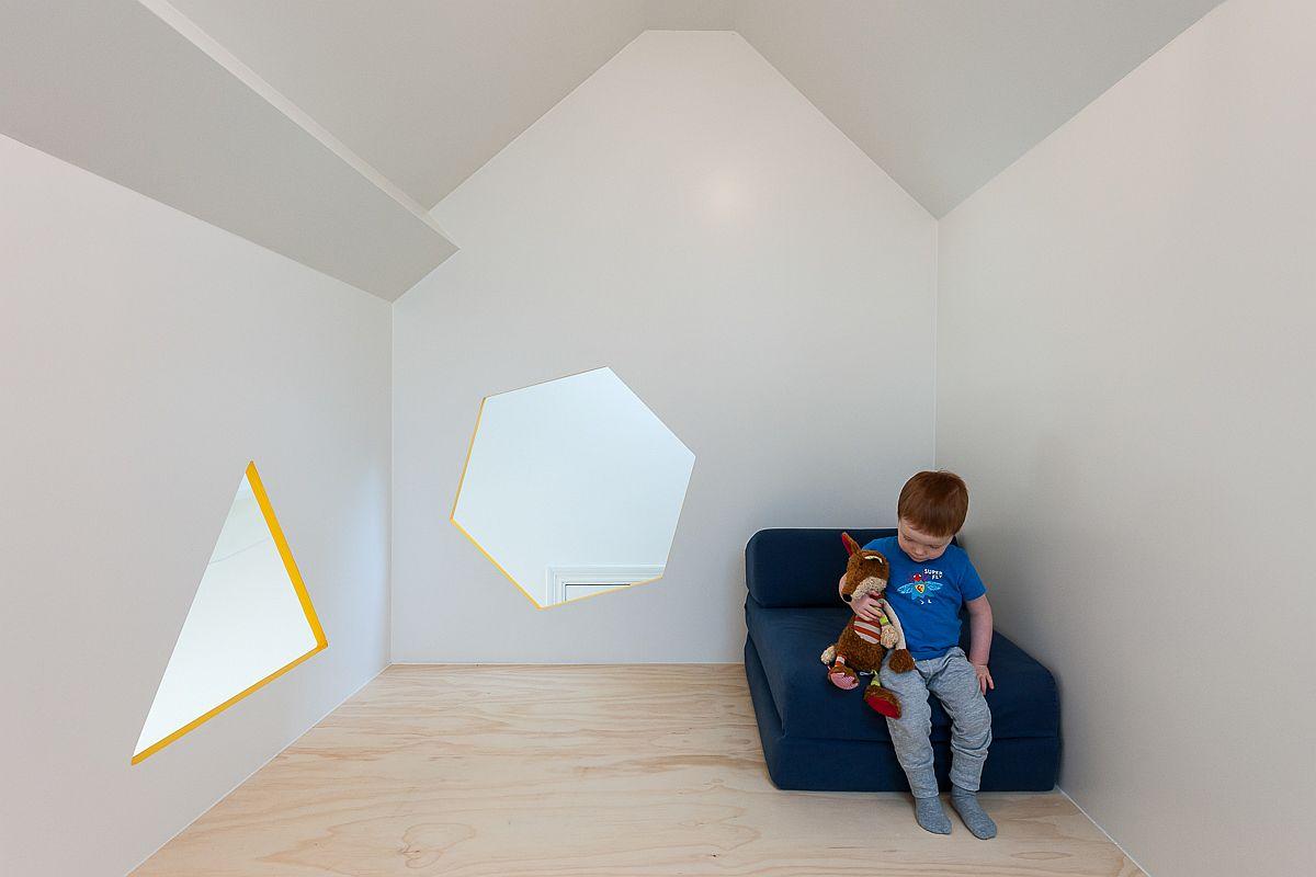 Fun-geometric-shaped-windows-for-the-loft-level-hideaway