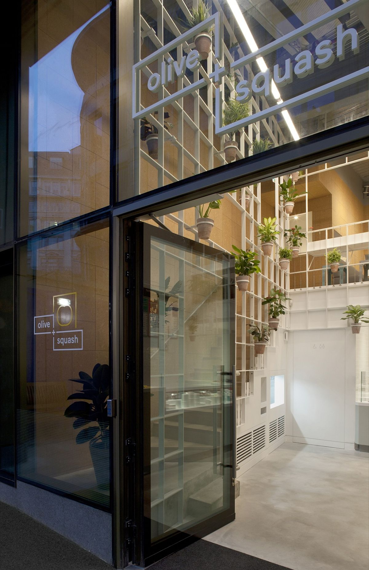 Glass-facade-of-the-Olive-Squash-in-London