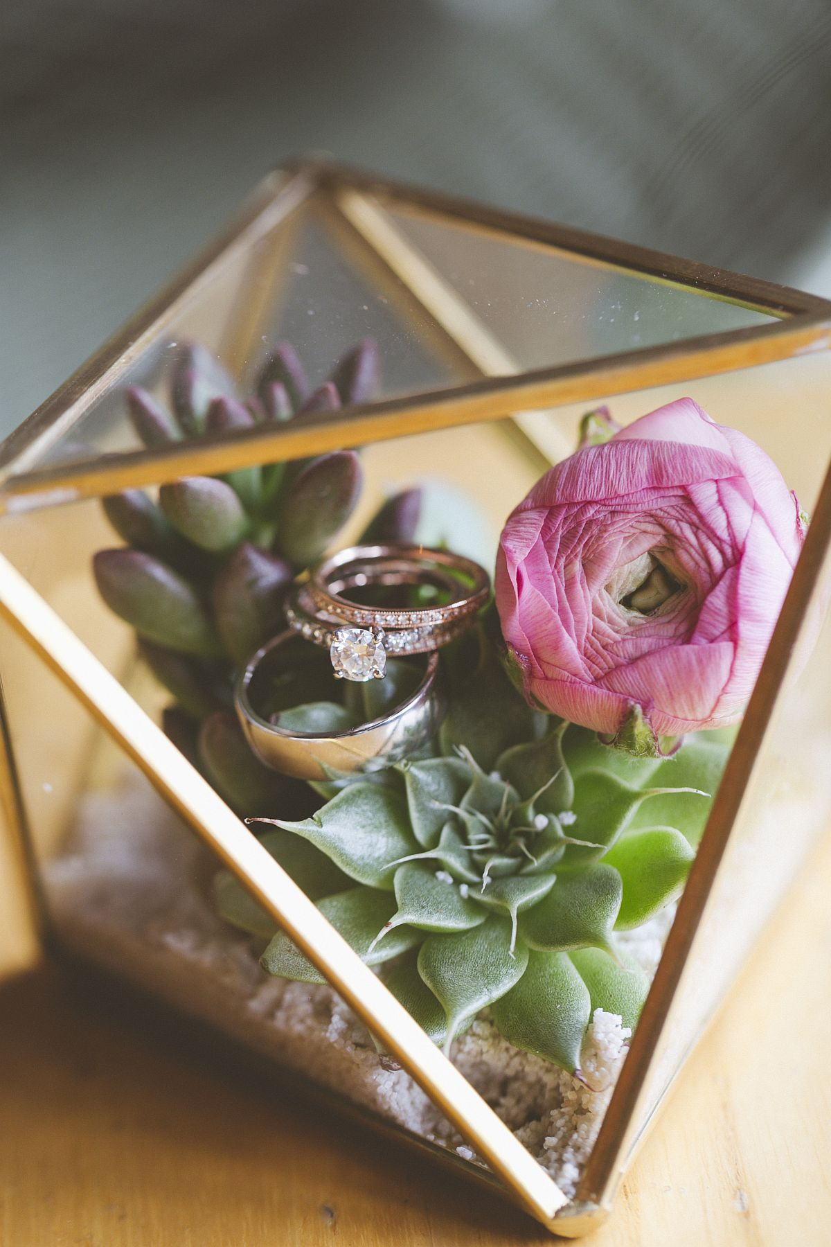 Gold geo terrarium box with wedding rings