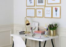 Golden-wall-gallery-in-a-white-office-217x155