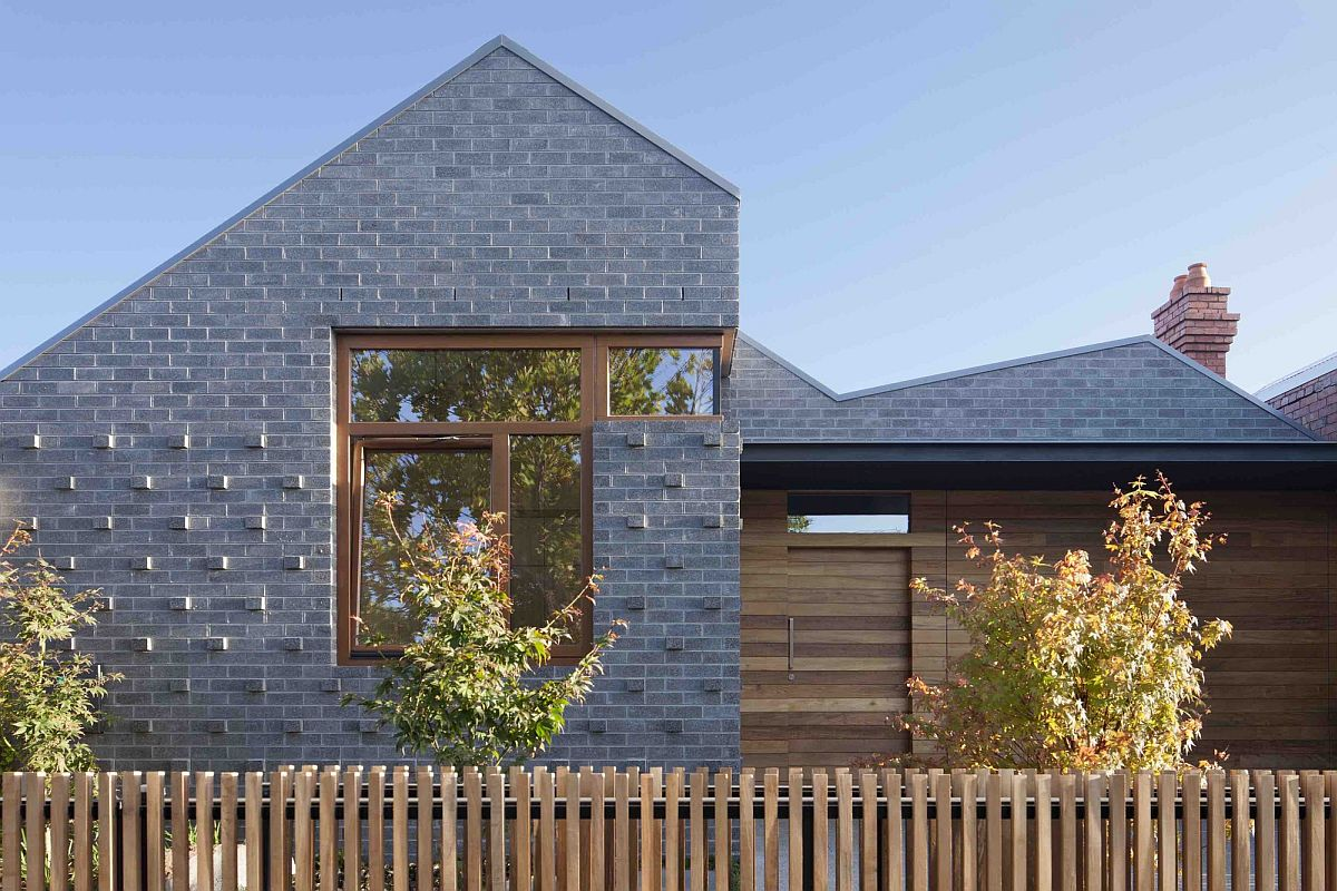 Gray tiles and wood give the house a unique exterior