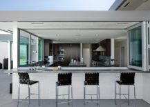 Half-open-outdoor-kitchen-with-a-classy-silver-look-217x155
