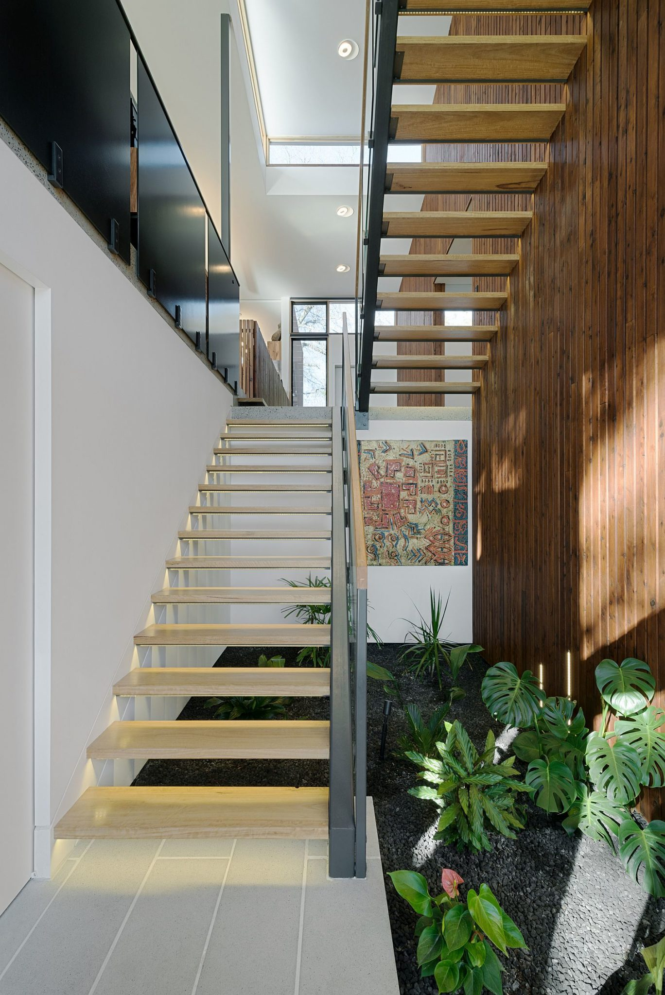 Indoor green nook under the staircase