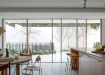 Kitchen-and-dining-area-connected-with-the-view-outside-217x155