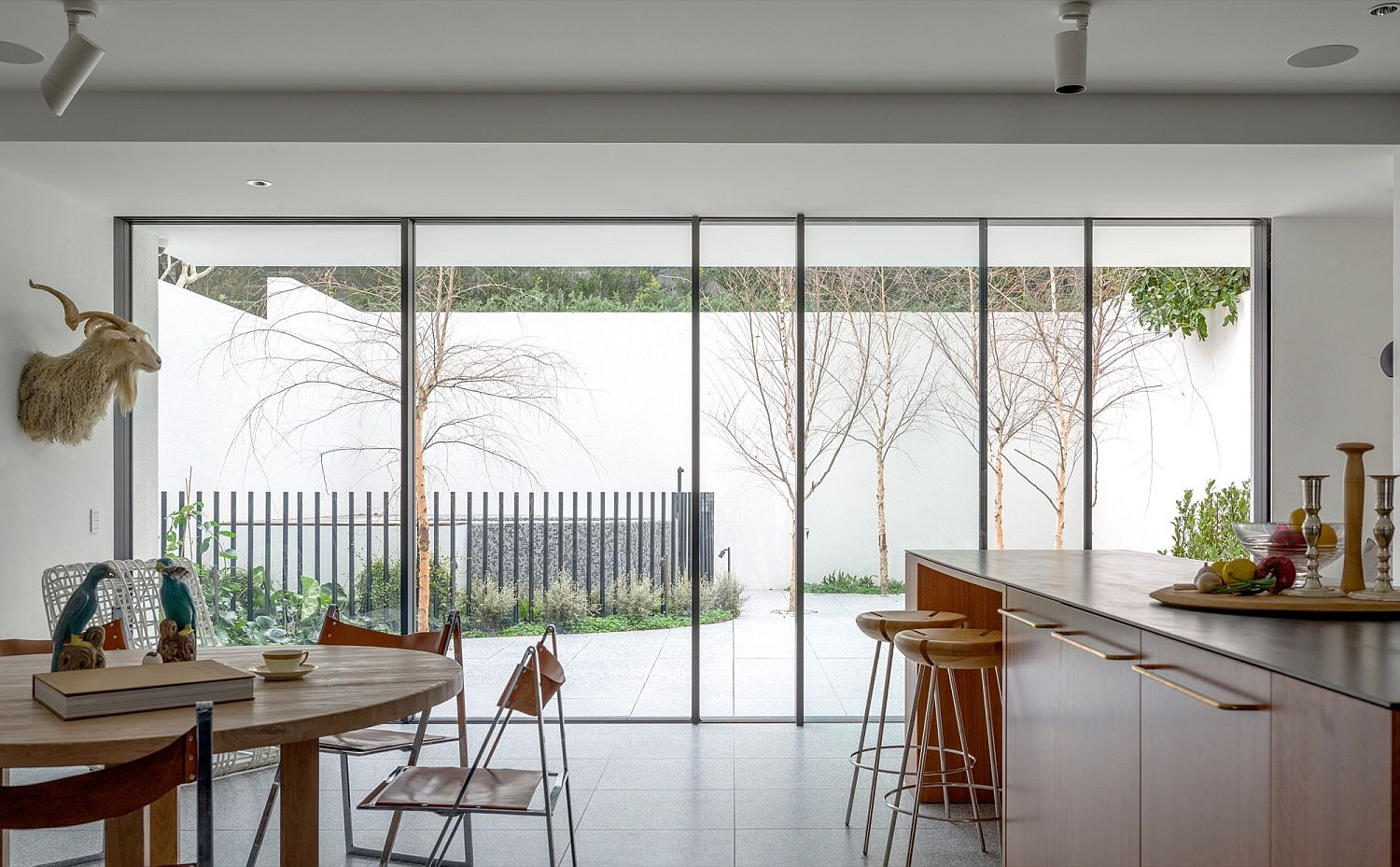 Kitchen and dining area connected with the view outside