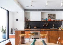 Kitchen-with-black-backsplash-comfy-seating-and-breakfast-bar-217x155