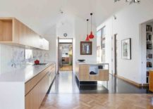 Large-and-open-kitchen-design-with-wooden-shelves-and-corian-countertops-217x155
