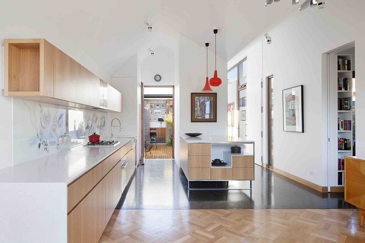 Large-and-open-kitchen-design-with-wooden-shelves-and-corian-countertops
