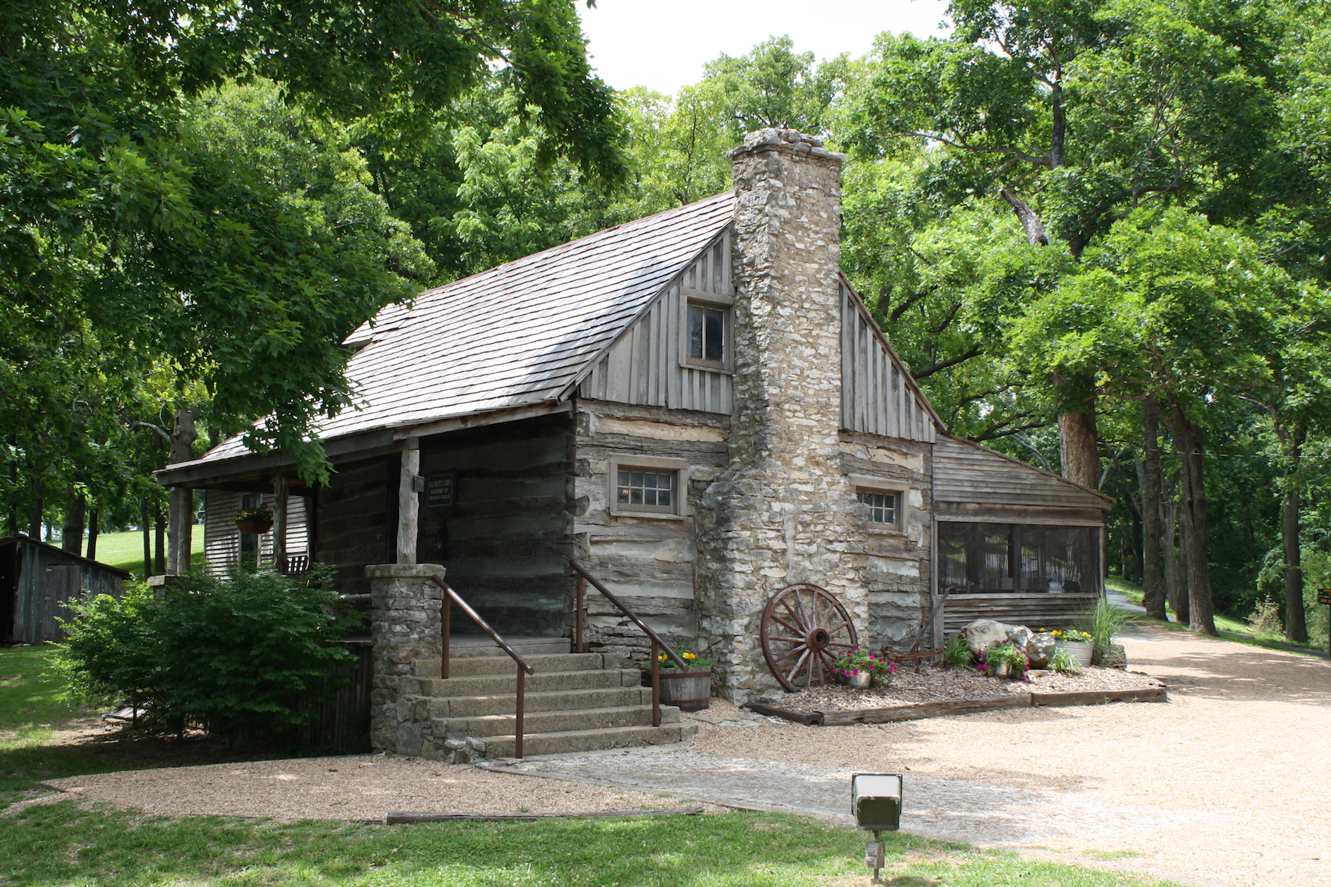 Large cottage with a big stone chimney