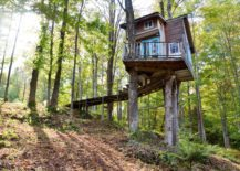 Little-wooden-treehouse-with-big-windows-217x155