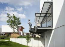 Lower-level-of-the-house-showcases-its-industrial-frame-217x155