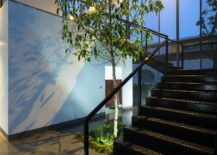 Metallic-staircase-connects-the-lower-level-with-the-meeting-room-on-top-floor-217x155