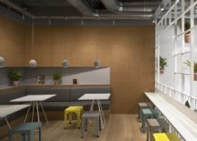 Mezzanine-level-dining-area-with-a-warm-inviting-look-217x155