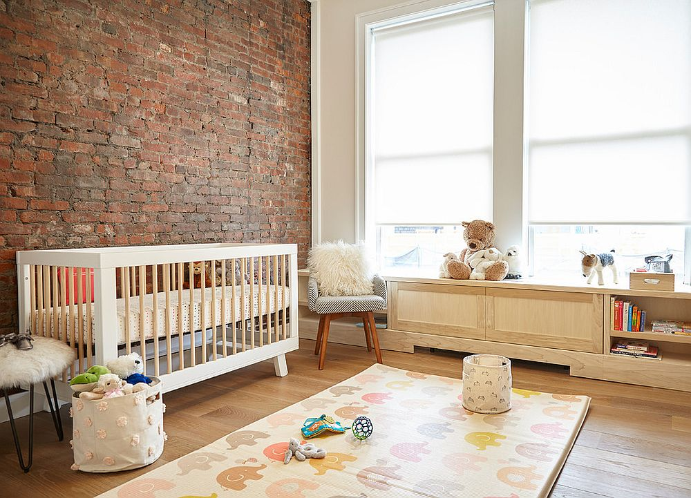 Modern industrial nursery with brick wall backdrop