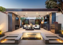Modern-outdoor-kitchen-doubling-as-a-cozy-lounge-corner-217x155