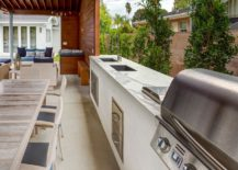Modern-outdoor-kitchen-with-a-marble-counter-217x155