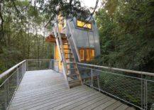 Modern-tin-treehouse-with-an-illuminated-interior-217x155