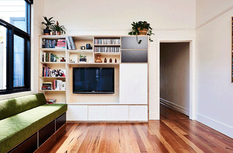 Movable doors cover the TV when not in use